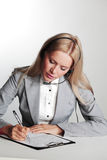 Business woman writing in notebook Stock Photography
