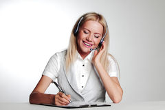 Business woman writing in notebook Stock Photos