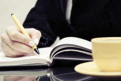 Business woman writing in notebook Royalty Free Stock Image