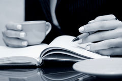 Business woman writing in notebook Royalty Free Stock Photography