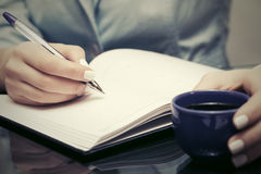 Business woman writing in notebook Stock Images