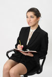 Business woman writing in a notebook Stock Images