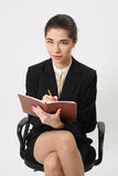 Business woman writing in a notebook Stock Photo