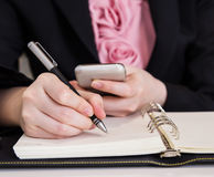 Business woman writing on notebook Royalty Free Stock Photography