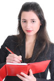 Business woman writing on a notepad Royalty Free Stock Image