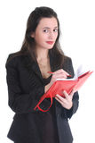Business woman writing on a notepad Stock Image