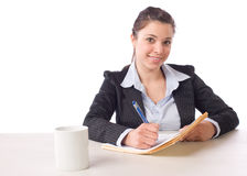Business Woman Writing notes at desk Royalty Free Stock Images