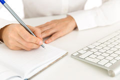 Business woman writing notes on a notebook Stock Photography