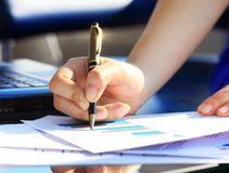 Business Woman Writing with pen Royalty Free Stock Photography