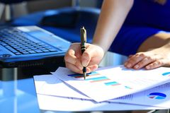 Business Woman Writing with pen Stock Photo