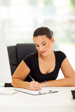 Business woman writing report Stock Photo