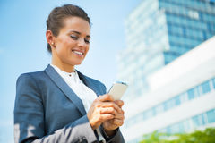 Business woman writing sms Stock Photo