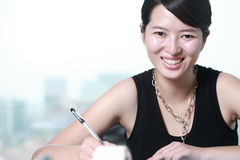 Business woman writing something Royalty Free Stock Images