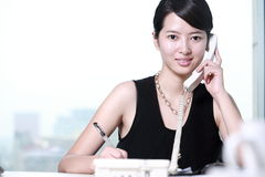 Business woman writing something Stock Photography