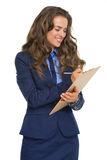 Business woman writing something in clipboard Royalty Free Stock Photography