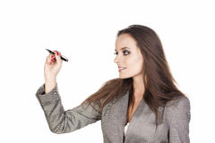 Business woman writing. Business woman writing something with a marker on white background royalty free stock image