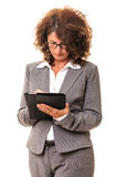 Business woman writing on tablet pc Stock Photo