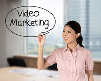 Business woman writing video marketing. With handwriting and circle Stock Photos