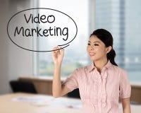 Business woman writing video marketing Stock Photos
