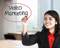 Business woman writing video marketing. With handwriting and circle Royalty Free Stock Photo