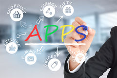 """Business woman writing the word """"APPS""""  with a marker on a transparent screen, with app icons Royalty Free Stock Image"""