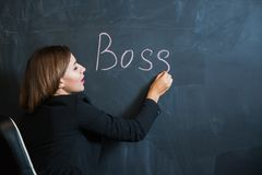 Business woman writing the word boss on desk Royalty Free Stock Photo