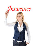 Business woman writing the word insurance Royalty Free Stock Photo