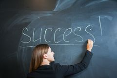Business woman writing the word success on desk Royalty Free Stock Photography