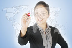 Business woman writing world map screen Royalty Free Stock Images