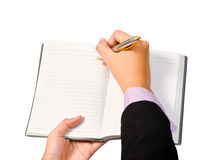 Business woman wrote on the notebook. Royalty Free Stock Images