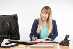 Business woman wrote in a notebook and looked into the frame Stock Photos