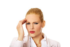 Business woman wtih huge head ache Royalty Free Stock Images