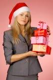 Business-woman y regalos Imágenes de archivo libres de regalías