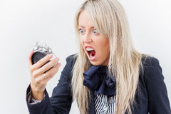 Business woman yelling on alarm clock Stock Photo