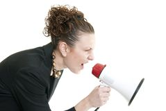 Business woman yelling into a bullhorn Royalty Free Stock Photography