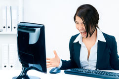 Business woman yelling at the monitor. Office and business Royalty Free Stock Photos