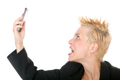 Business woman yelling at phone Stock Photo