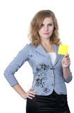 Business woman with in a yellow leaf in her hands. Young woman shows a yellow sheet of paper Royalty Free Stock Image