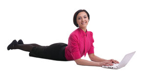 Business woman in yoga sphinx pose type computer Royalty Free Stock Images