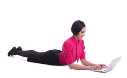 Business woman in yoga sphinx pose type on laptop Stock Images