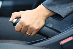 Business womanput the hand brake car . Stock Image