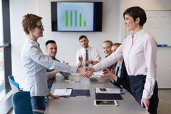 Business womans handshake Stock Image