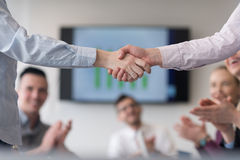 Business womans handshake Stock Photos