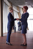 Business womans make deal and handshake Stock Photos