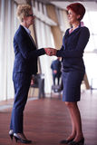 Business womans make deal and handshake Stock Photo
