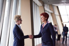 Business womans make deal and handshake Stock Photography