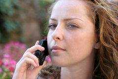 Business women. Young pretty women talking on phone Royalty Free Stock Photos