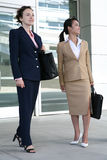 Business Women. Two attractive business woman leaving their company Stock Photo