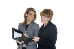 Business Women. Two business women discuss information before a briefing stock photo