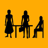 Business women. Three Business women silhouettes on orange - additional ai and eps format available on request Royalty Free Stock Photo